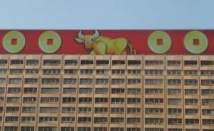 Building in Hong Kong with electronic moving billboard featuring the Ox and lucky gold coins for New Year